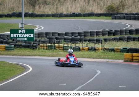 Go Kart driver on the track
