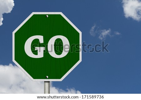 Go Sign, An American road sign and words Go with blue sky - stock photo