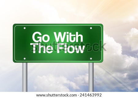 Go With The Flow Green Road Sign, business concept  - stock photo