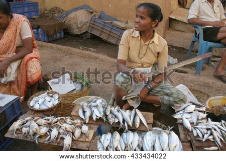 Goa, India - February 11, 2006: Fish seller looks for customers. The Market in Chaudi.