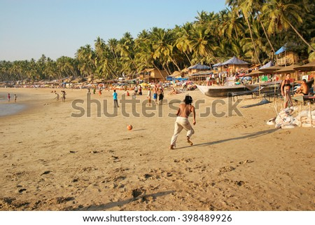 Goa, India - January 31, 2006: People relax on the Palolem beach