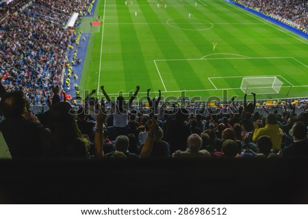Goal celebration. Soccer. Football. A goal is celebrated for the supporters of a team in a soccer stadium. Happy soccer fans are celebrating a goal.  - stock photo