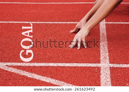 Goal - hands on starting line - stock photo