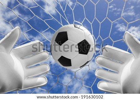 Goal keeper fail catching soccer ball with blue sky - stock photo