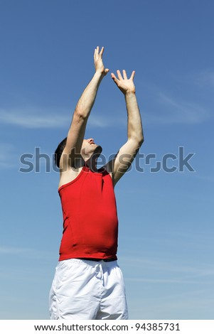 goal raising hand to heaven to catch the ball - stock photo