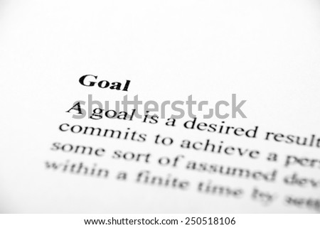 Goal with some other related words on paper. - stock photo