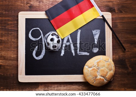 Goal written on board with bun in form of football german flag - stock photo