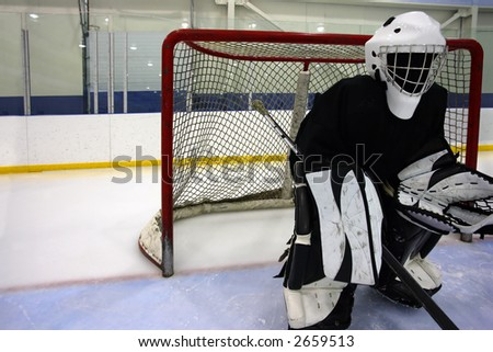 Goalie waiting for the action to come their way. - stock photo