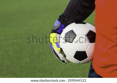 Goalkeeper catches the ball . At the stadium - stock photo
