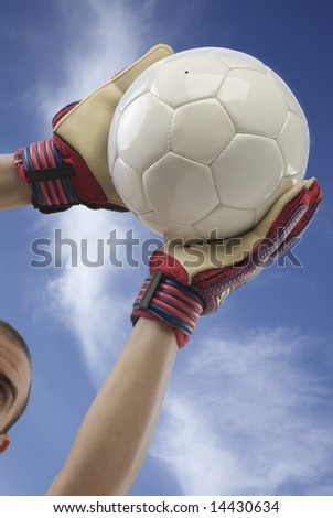 goalkeeper catching the ball - stock photo