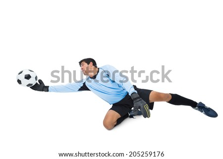 Goalkeeper in blue making a save on white background - stock photo