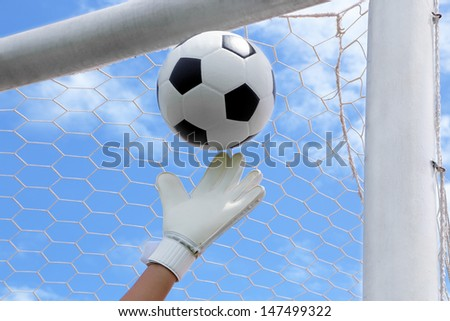 Goalkeeper (termed goaltender, netminder, goalie, or keeper in some sports) is a designated player charged with directly  preventing the opposing team from scoring by intercepting shots at goal. - stock photo