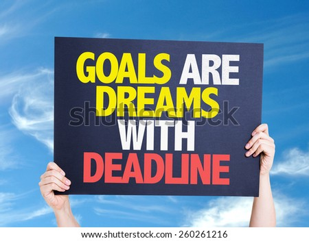 Goals Are Dreams With Deadline card with sky background - stock photo