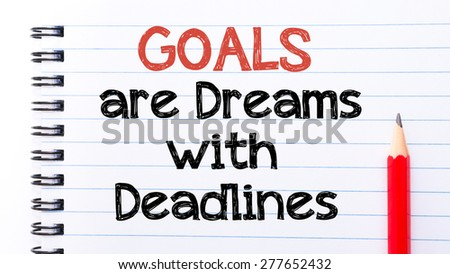 Goals Are Dreams with Deadlines Text written on notebook page, red pencil on the right. Motivational Concept image
