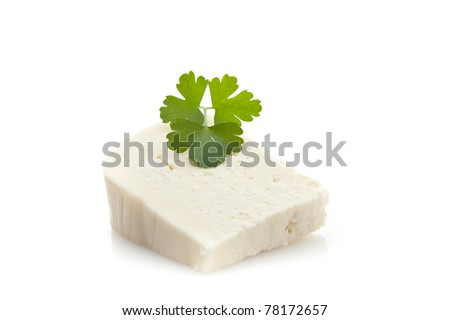 Goat cheese with fresh parsley - stock photo
