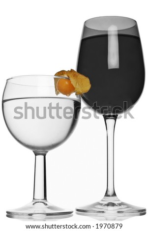 goblet of red and white wine with selective coloring of physallis fruit - stock photo