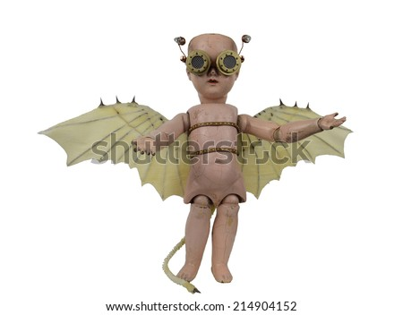 Goblin steam punk creepy doll with Da Vinci bat wings and aviator goggles standing isolated on white - stock photo