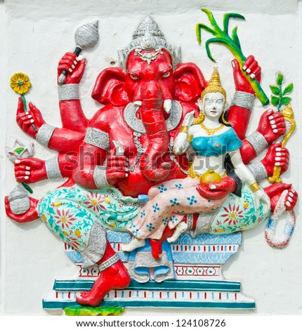 God of success 25 of 32 posture. Indian style or Hindu God Ganesha avatar image in stucco low relief technique with vivid color,Wat Samarn, Chachoengsao,Thailand. - stock photo