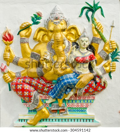 God of success 30 of 32 posture. Indian style or Hindu God Ganesha avatar image in stucco low relief technique with vivid color,Wat Samarn, Chachoengsao,Thailand. - stock photo