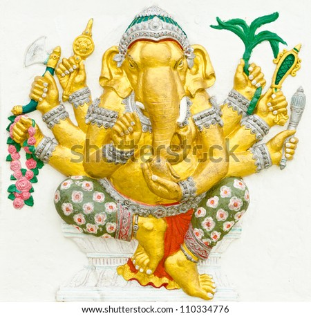 God of success 9 of 32 posture. Indian style or Hindu God Ganesha avatar image in stucco low relief technique with vivid color,Wat Samarn, Chachoengsao,Thailand. - stock photo