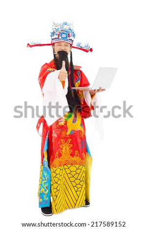 God of wealth holding a laptop and thumb up over white background - stock photo