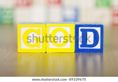 GOD Spelled Out in Alphabet Building Blocks - stock photo