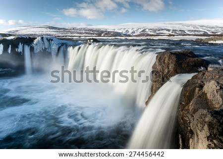 Godafoss is a very beautiful Icelandic waterfall. It is located on the North of the island not far from the lake Myvatn and the Ring Road. - stock photo