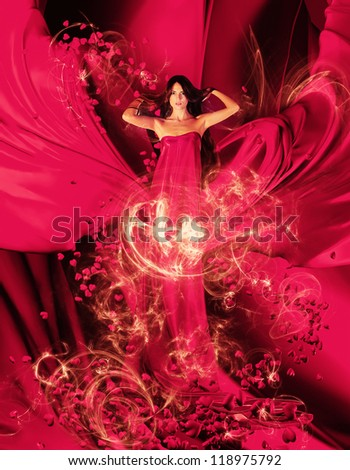 goddess of love in long red dress with magnificent long hair makes a magic ritual of connecting hearts of people on red drapery, fabric