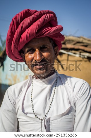 GODWAR REGION, INDIA - 13 FEBRUARY 2015: Rabari tribesman stands in courtyard of home wearing traditional clothes. Rabari or Rewari are an Indian community in the state of Gujarat.