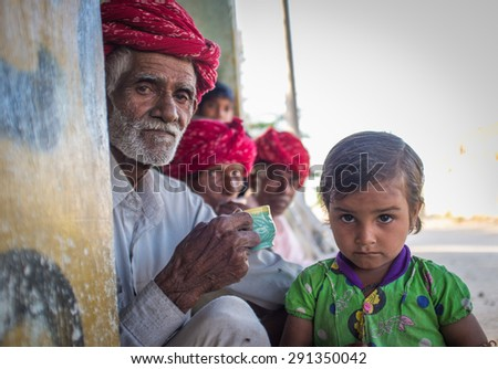 GODWAR REGION, INDIA - 12 FEBRUARY 2015: Rabari tribesman with other members while granddaughter stands next to him. Rabari or Rewari are an Indian community in the state of Gujarat. - stock photo