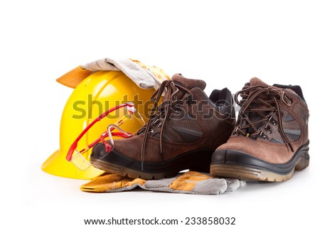 Goggles, boots, yellow hard hat and gloves on a white background - stock photo