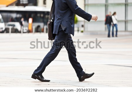 Going businessman. Urban scene. - stock photo