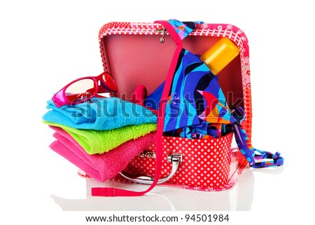 Going on vacation; accessories and suitcase over white background - stock photo