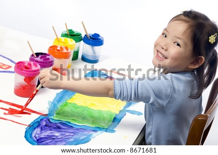 Going to school is your future. Education, learning, teaching. a young girl coloring a picture - stock photo