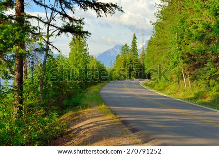 Going to the sun road near McDonald lake in Glacier National Park, Montana in summer - stock photo