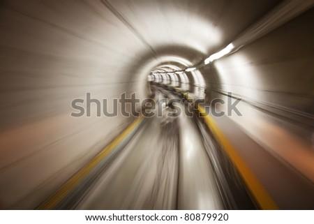 Going trough the underground tunnel (Zurich airport) - stock photo