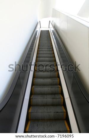 going up the escalator - stock photo