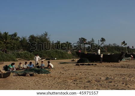 GOKARNA, INDIA - DECEMBER 16: Fishermen from Indian state Karnataka, prepare gear for fishing in the Indian ocean, December 16, 2008 in Gokarna, India. - stock photo