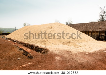 Gokarna, India - February, 21, 2016: Sanikatta is the oldest (from 1720) natural salt manufacturing in Karnataka state, near Gokarna city. Pile of non-refine salt on the factory