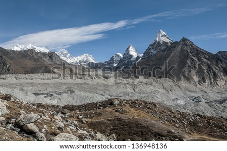 Gokyo glacier with mounts Everest, Nuptse, Lhotse, Nirekha, Kangchung, and Chola in background in the area of Cho Oyu - Gokyo region, Nepal, Himalayas