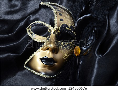 Gold a carnival mask with black feathers - stock photo