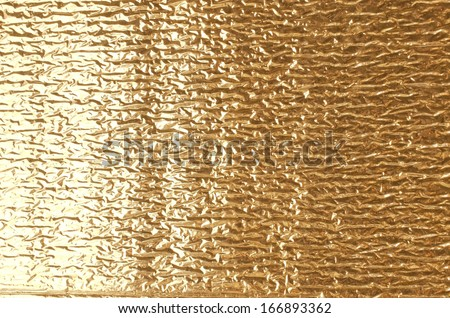 Gold aluminum foil texture closeup , can be used for background - stock photo