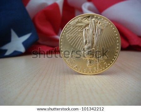 Gold American Eagle, $50 Gold Piece, One Troy Ounce of Gold, Upside Down Economy, Liberty Standing on Head - stock photo