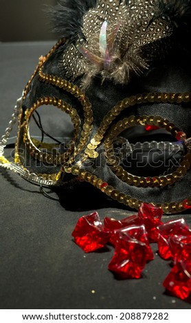 Gold and Black Mask with Red Rubies - stock photo