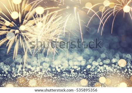 Gold and green Fireworks and bokeh in New Year eve and copy space. Abstract background holiday.
