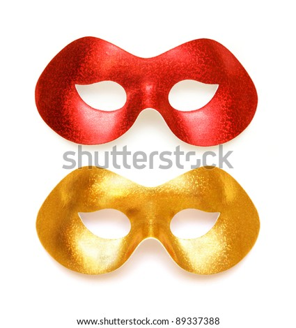 Gold and red carnival masks on a white background - stock photo
