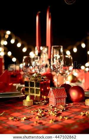 gold and red christmas table decoration with dim light candle