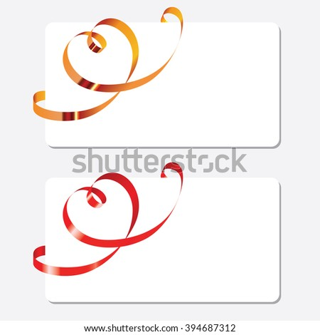 Gold and red curling ribbons in shape of heart over the greeting cards. Horizontal orientation - stock photo