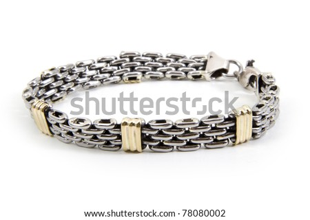 Gold and silver bracelet over white background