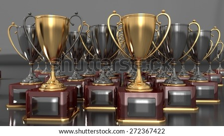 gold and silver cups- award for winners - stock photo